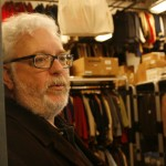 "Theater and film department chair Ron Shields opens the door to what he calls the ""Taj Mahal"" of costume shops. Photo by Sara Shipley Hiles."